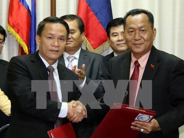 Vietnam-Laos : cooperation entre agences de presse hinh anh 1