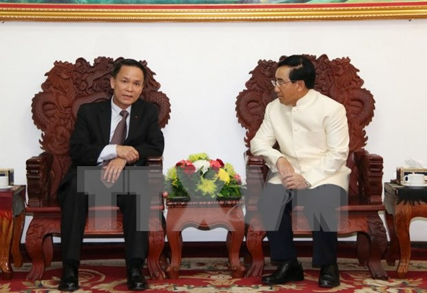 Le vice-Premier ministre laotien recoit le directeur general de la VNA hinh anh 1