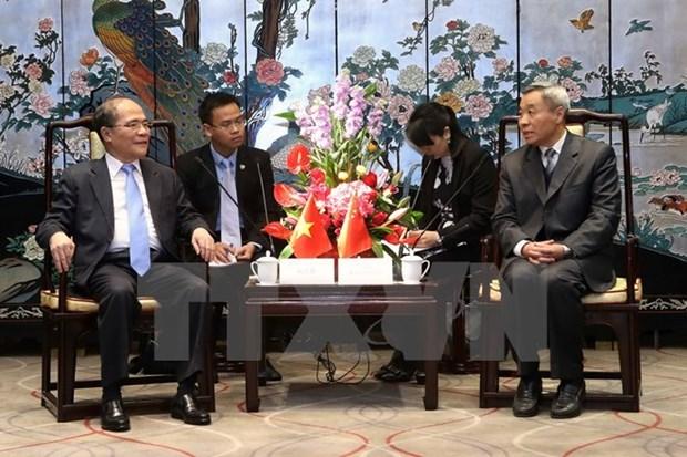 Le president Nguyen Sinh Hung rencontre le president de l'ANP du Guangdong hinh anh 1