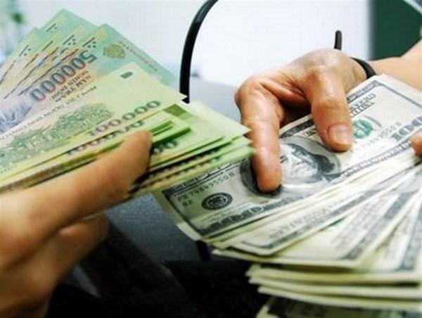 Depreciation du dollar americain face au dong vietnamien hinh anh 1