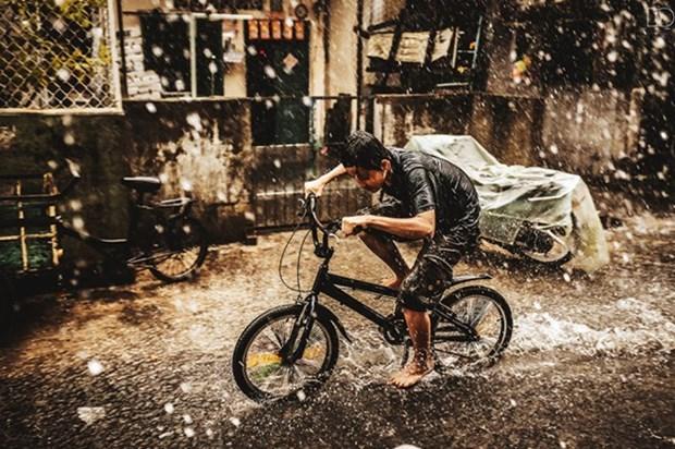 Cinq photographes zooment sur la vie des rues a Sai Gon hinh anh 1