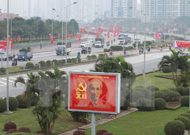 Xinhua et Kyodo couvrent le XIIe Congres national du PCV hinh anh 1
