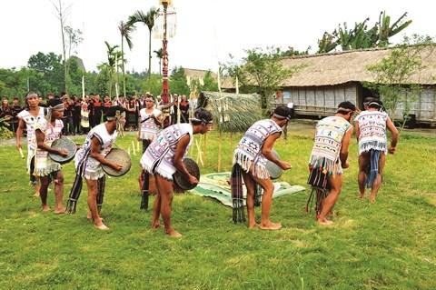 Le mat rituel, protecteur de la famille durant le Tet hinh anh 1