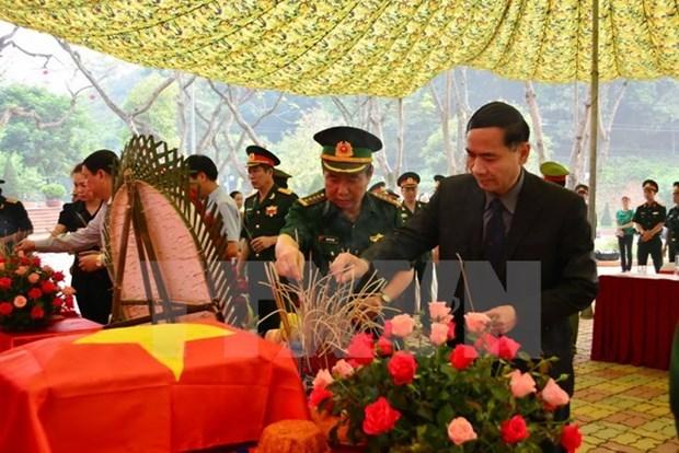 Remise des restes de martyrs tombes au champ d'honneur au Laos hinh anh 1