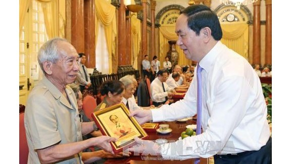 Le president Tran Dai Quang rencontre des anciens gardiens de l'Oncle Ho hinh anh 1
