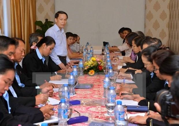 Echange professionnel entre journalistes vietnamiens et laotiens hinh anh 1