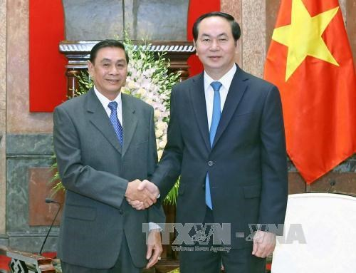 Le president Tran Dai Quang recoit le chef du Bureau de la presidence du Laos hinh anh 1