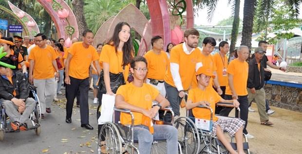 Diverses activites pour celebrer le 55e anniversaire du desastre de l'agent orange au Vietnam hinh anh 2
