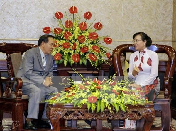 Cooperation efficiente dans le travail du front entre HCM-Ville et Vientiane hinh anh 1