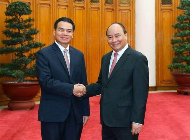 Nguyen Xuan Phuc recoit le president du Bureau du gouvernement laotien hinh anh 1