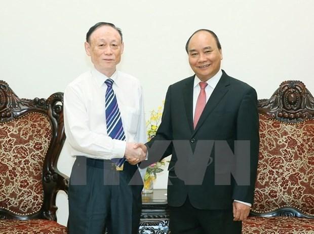 Le chef du gouvernement vietnamien recoit le president du groupe chinois JA Solar hinh anh 1