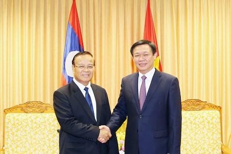 Renforcement de la cooperation avec le Laos dans les finances publiques hinh anh 1