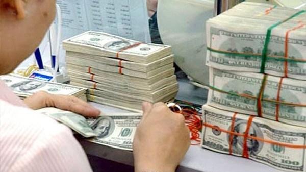 2,5 milliards de dollars de devises transferees a HCM-Ville depuis janvier hinh anh 1