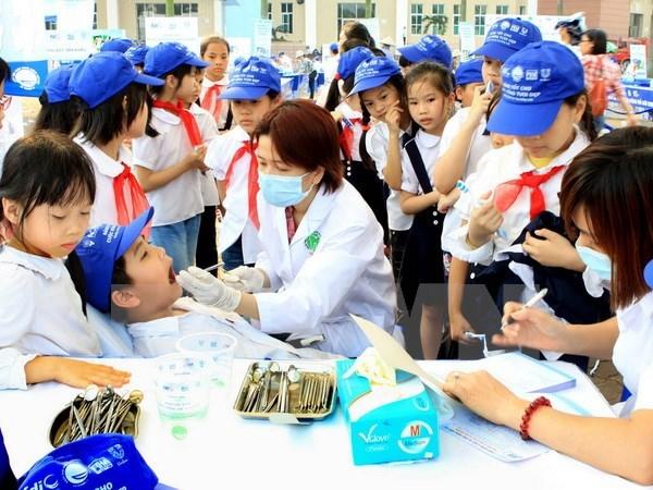 Conference d'odonto-maxillo-faciologie a Hanoi hinh anh 1