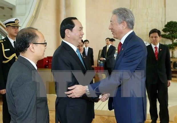 Le president Tran Dai Quang termine sa visite a Singapour hinh anh 1