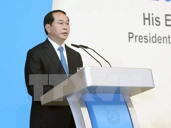 Le president Tran Dai Quang termine sa visite a Singapour hinh anh 3