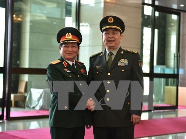 Entretien entre les ministres vietnamien et chinois de la Defense hinh anh 1