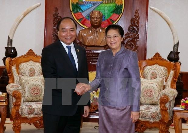 Le PM Nguyen Xuan Phuc rencontre les plus hauts dirigeants laotiens hinh anh 3