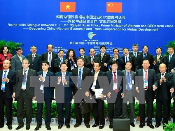 Le Premier ministre dialogue avec des hommes d'affaires chinois hinh anh 1
