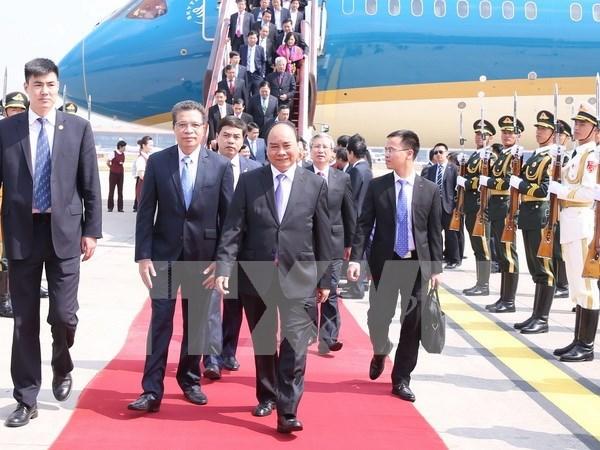Le PM Nguyen Xuan Phuc est arrive a Pekin pour une visite officielle en Chine hinh anh 1