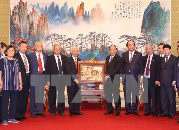 Le PM rencontre des amis chinois ayant soutenu le Vietnam pendant la guerre hinh anh 1