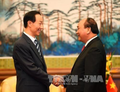 Le Premier ministre Nguyen Xuan Phuc poursuit ses activites en Chine hinh anh 1