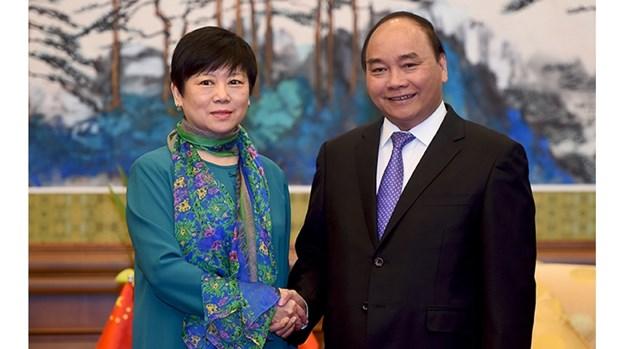 Le Premier ministre Nguyen Xuan Phuc poursuit ses activites en Chine hinh anh 2
