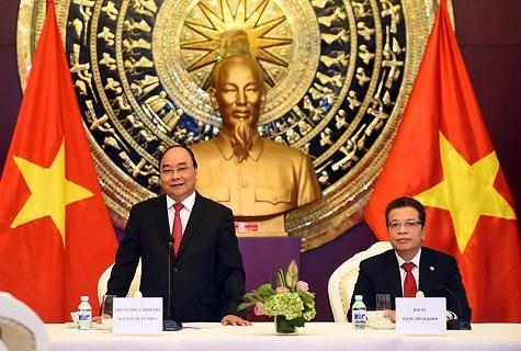 Le Premier ministre Nguyen Xuan Phuc poursuit ses activites en Chine hinh anh 3