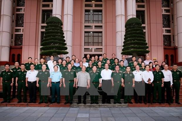 Le chef du gouvernement travaille avec le ministere de la Defense hinh anh 1