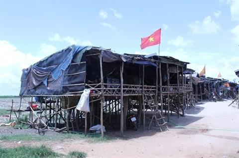 Resoudre les difficultes des Viet kieu revenus du Cambodge hinh anh 1