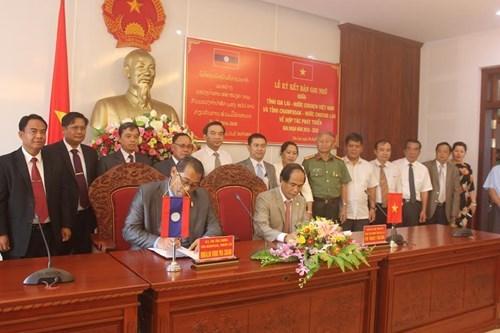 Gia Lai et Champassak signent un memorandum de cooperation pour le developpement hinh anh 1