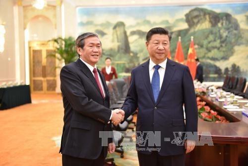 Le Vietnam prend en consideration les relations avec la Chine hinh anh 1