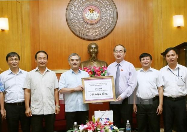 Environ 300 millions de dongs de la VNA mobilises pour la population du Centre hinh anh 1