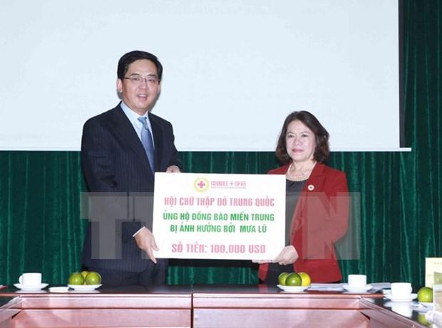Aide de la Croix-Rouge chinoise pour les populations sinistrees du Centre hinh anh 1