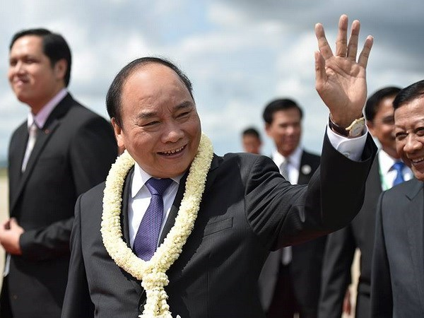 Le PM Nguyen Xuan Phuc est arrive au Cambodge pour participer au 9e Sommet CLV hinh anh 1