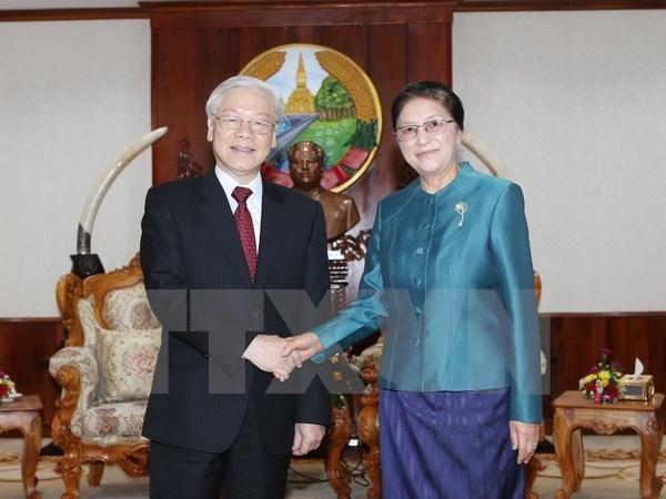 Le SG Nguyen Phu Trong s'entretient avec des hauts dirigeants laotiens hinh anh 1