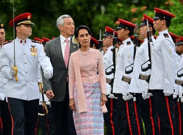 La conseillere d'Etat du Myanmar effectue une visite officielle a Singapour hinh anh 1