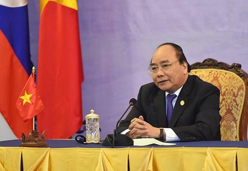 Remise de 5 tonnes de riz aux Viet kieu demunis de Siem Reap hinh anh 1