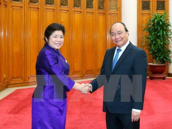 Nguyen Xuan Phuc recoit la ministre du bureau du Premier ministre laotien hinh anh 1
