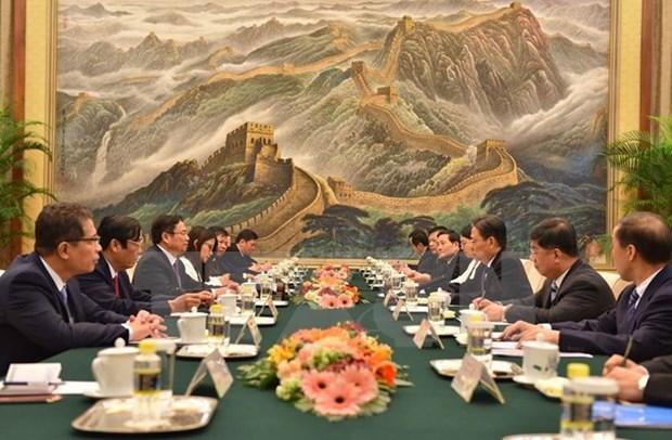 La Chine prend toujours en haute consideration ses relations avec le Vietnam hinh anh 1