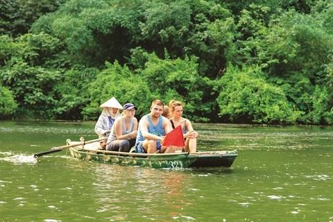 En sampan a Trang An, patrimoine mondial de l'UNESCO hinh anh 2