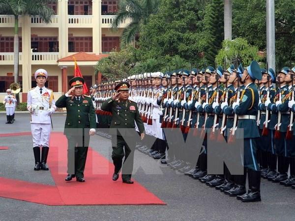 Renforcement de la cooperation de defense entre le Vietnam et le Laos hinh anh 1