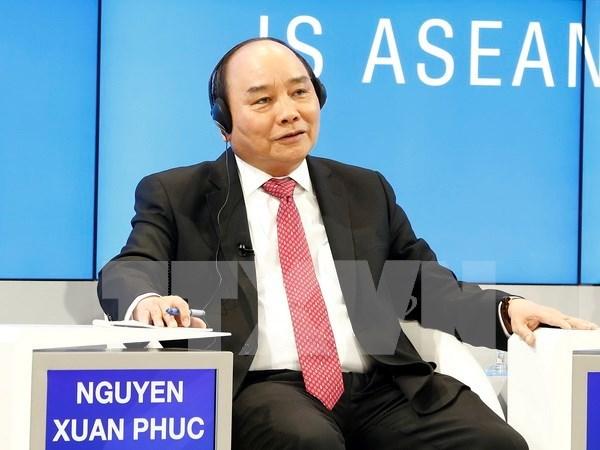 Le PM termine son voyage a Davos pour le Forum economique mondial hinh anh 1
