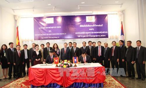 Le Vietnam et le Laos renforcent leur cooperation bancaire hinh anh 1