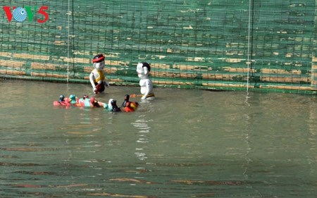 A Dao Thuc, les marionnettes sur eau dansent au rythme des traditions hinh anh 4