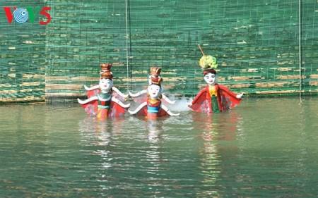 A Dao Thuc, les marionnettes sur eau dansent au rythme des traditions hinh anh 1