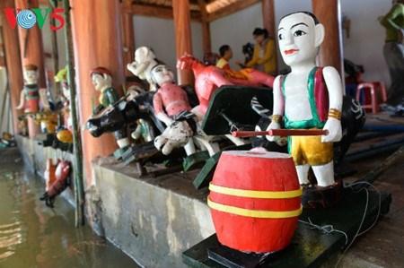 A Dao Thuc, les marionnettes sur eau dansent au rythme des traditions hinh anh 3