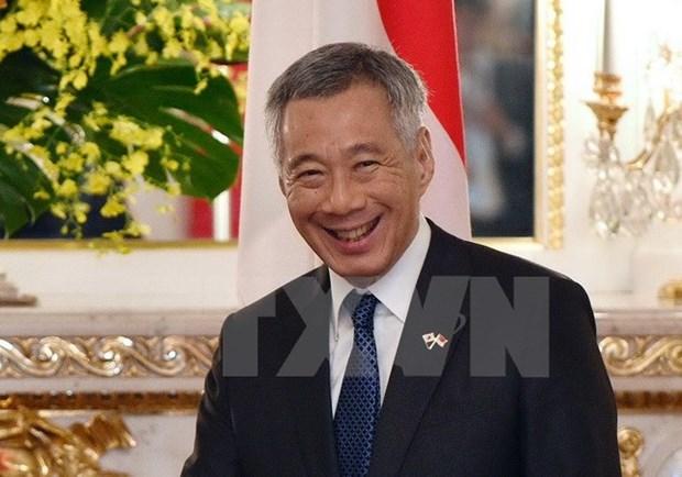 Le Premier ministre singapourien entame sa visite officielle au Vietnam hinh anh 1
