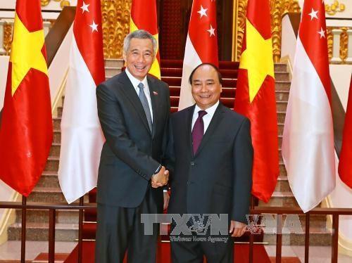Le Vietnam et Singapour approfondissent leur partenariat strategique hinh anh 1