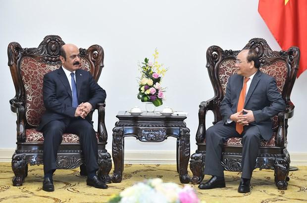 Nguyen Xuan Phuc recoit l'ambassadeur du Qatar hinh anh 1